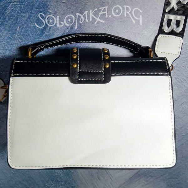 Жіноча сумочка на плече - левова голова. Клатч в заклепках