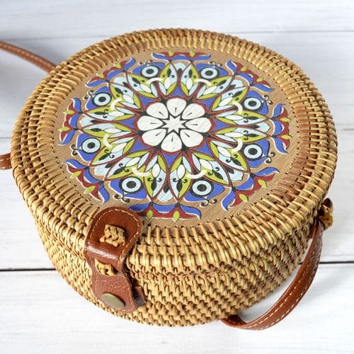 Female round rattan bag with handmade floral print